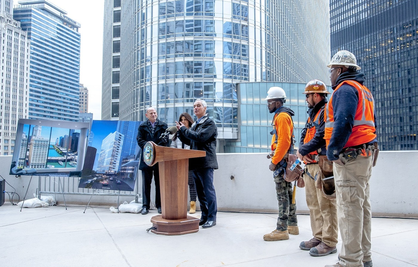 Rahm speaking at crane presser
